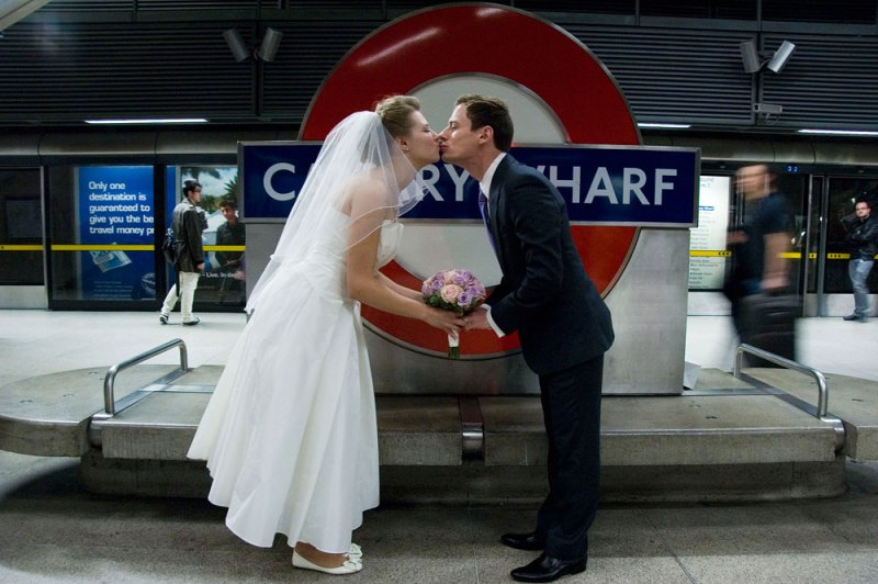 Bride and groom at Canary Wharf station.
